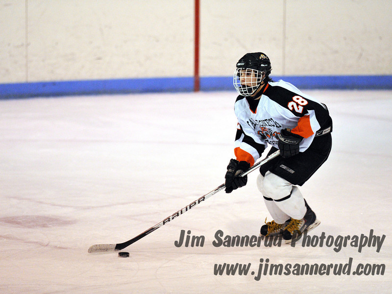 Junior defenseman #28 Brian Schiff. White Plains High School Tigers vs. Mamaroneck Tigers Varsity Ice Hockey at Hommocks Park Ice Rink, Friday, December 21, 2012, White Plains lost 3-1