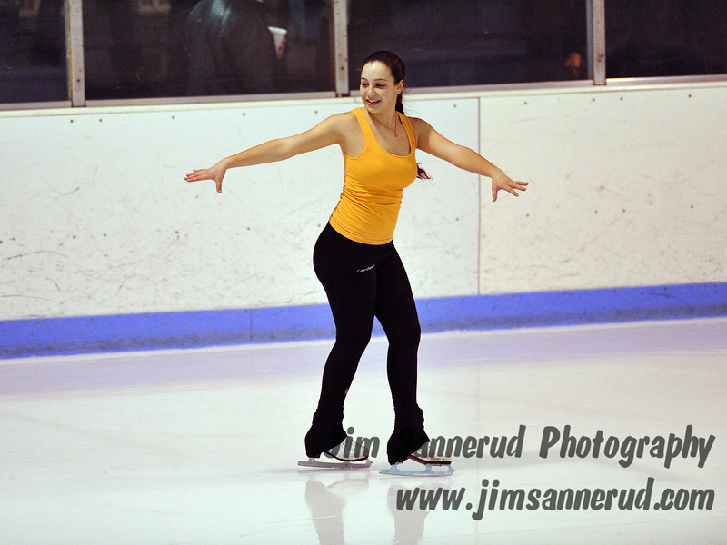 This lovely ice skater put on a solo figure skating exhibition between periods at our hockey game. White Plains High School Tigers vs. Mamaroneck Tigers Varsity Ice Hockey at Hommocks Park Ice Rink, Friday, December 21, 2012, White Plains lost 3-1