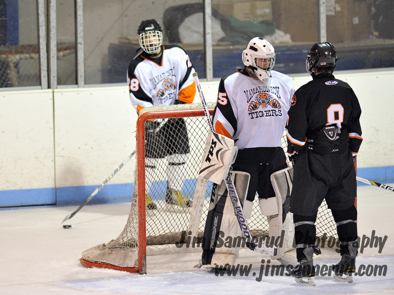 In the waning seconds of a 3-1 game, both teams were content to let the clock run out. Schiff held the puck behind his net while McGee appears to be having a friendly chat with the Mamaroneck goaltender. White Plains High School Tigers vs. Mamaroneck Tigers Varsity Ice Hockey at Hommocks Park Ice Rink, Friday, December 21, 2012, White Plains lost 3-1