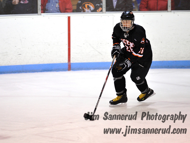 Junior defenseman #26 Casey McMahon moving the puck out of the White Plains zone. White Plains High School Tigers vs. Mamaroneck Tigers Varsity Ice Hockey at Hommocks Park Ice Rink, Friday, December 21, 2012, White Plains lost 3-1
