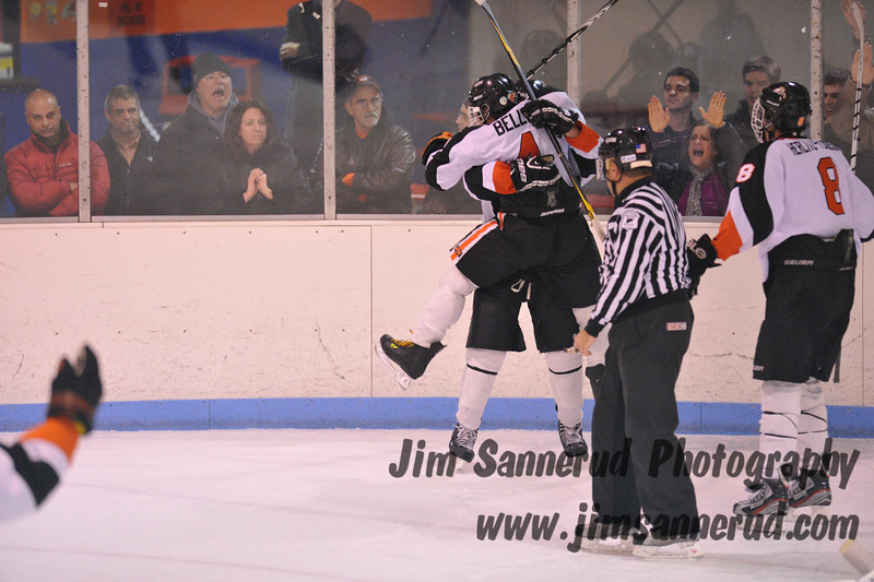 Mamaroneck players celebrating after going up 3-1 late in the third period. Can you tell which group of fans are from White Plains and which are from Mamaroneck? White Plains High School Tigers vs. Mamaroneck Tigers Varsity Ice Hockey at Hommocks Park Ice Rink, Friday, December 21, 2012, White Plains lost 3-1