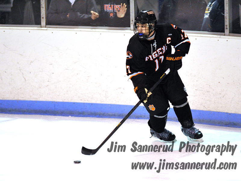 Chris Medeot carrier the puck around behind the White Plains net. White Plains High School Tigers vs. Mamaroneck Tigers Varsity Ice Hockey at Hommocks Park Ice Rink, Friday, December 21, 2012, White Plains lost 3-1