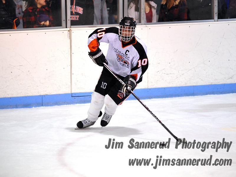 Mamaroneck senior defenseman #10 Josh Kriss looks to make a pass. White Plains High School Tigers vs. Mamaroneck Tigers Varsity Ice Hockey at Hommocks Park Ice Rink, Friday, December 21, 2012, White Plains lost 3-1