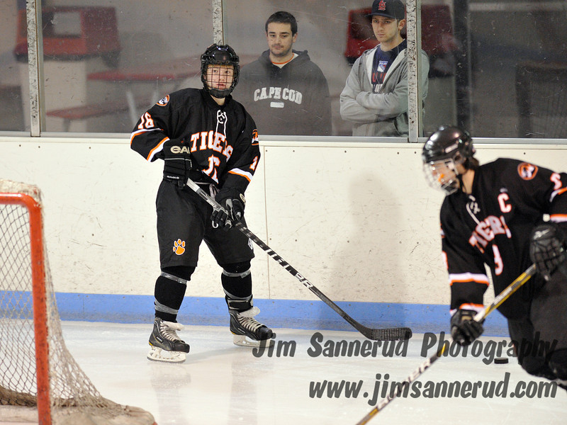 Liam Broderick #16 has the puck behind his own net. White Plains High School Tigers vs. Mamaroneck Tigers Varsity Ice Hockey at Hommocks Park Ice Rink, Friday, December 21, 2012, White Plains lost 3-1