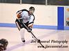 Senior defenseman Josh Kriss, #10, moves the puck up ice. White Plains High School Tigers vs. Mamaroneck Tigers Varsity Ice Hockey at Hommocks Park Ice Rink, Friday, December 21, 2012, White Plains lost 3-1