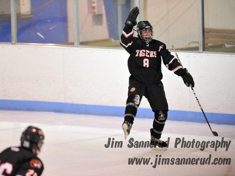 Kevin McGee #8 celebrating his goal. White Plains High School Tigers vs. Mamaroneck Tigers Varsity Ice Hockey at Hommocks Park Ice Rink, Friday, December 21, 2012, White Plains lost 3-1