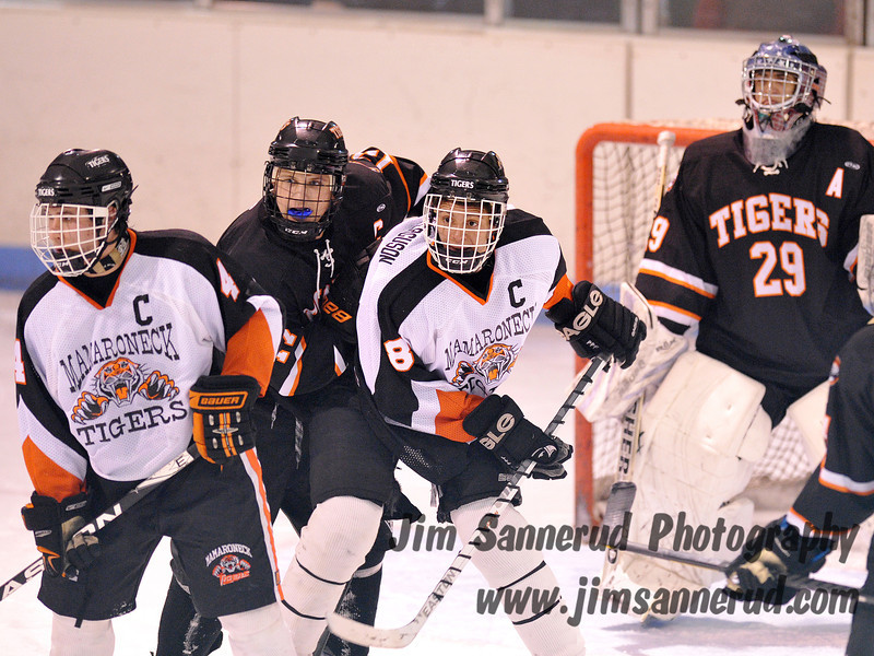 Junior defenseman #17 Chris Medeot has his hands full in front of the White Plains net. White Plains High School Tigers vs. Mamaroneck Tigers Varsity Ice Hockey at Hommocks Park Ice Rink, Friday, December 21, 2012, White Plains lost 3-1