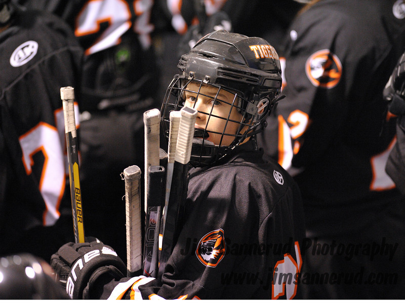 Freshman forward Brendan McDonough, #27, is in charge of extra sticks. White Plains High School Tigers vs. Mamaroneck Tigers Varsity Ice Hockey at Hommocks Park Ice Rink, Friday, December 21, 2012, White Plains lost 3-1