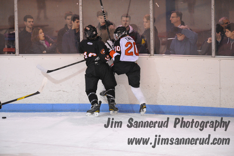 White Plains freshman defender Liam Broderick #16 was called for interference on this play. Mamaroneck scored their third goal on the resulting power play. White Plains High School Tigers vs. Mamaroneck Tigers Varsity Ice Hockey at Hommocks Park Ice Rink, Friday, December 21, 2012, White Plains lost 3-1