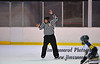Referee signals a delayed offsides. White Plains vs. Pelham at Ebersole Modified Ice Hockey, February 13, 2012