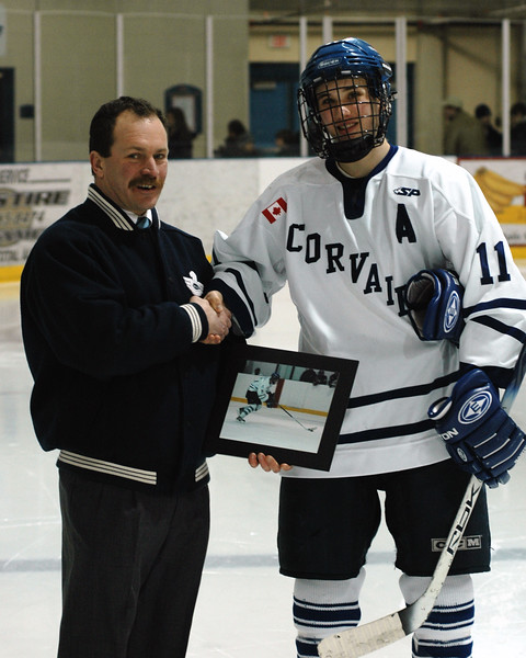 Caledonia Corvair Manager Scott Miller presents Nyle Brown of the Caledonia Corvairs the Caledonia Wireless Telus Corvair Player of the Month Nyle also receives a Sports Portrait from Bill Mehlenbacher.