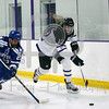 Holy Cross forward Scott Pooley (12) Air Force defenseman Abood, Dylan (23)