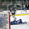 Saturday February 13, 2016 Worcester, Massachusetts; Holy Cross forward Scott Pooley (12) takes a shot during the first period against the Air Force Falcons during the first period with Air Force defenseman Abood, Dylan (23) diving across. The Air Force Academy won the game 4-2 at Hart Rink.