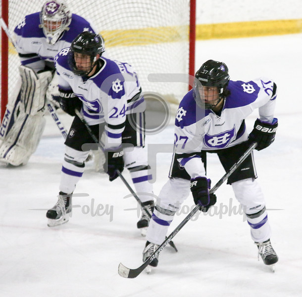 Holy Cross Tommy Muratore (24) and Danny Lopez (27)