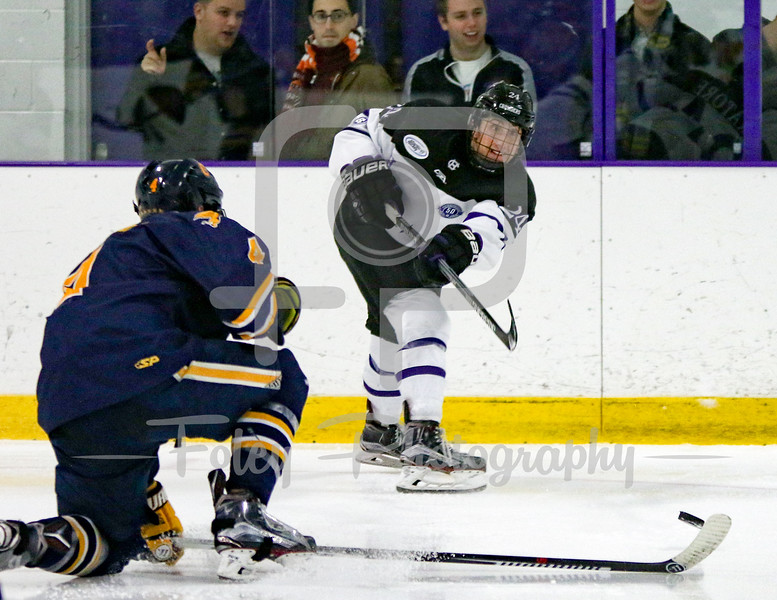 Holy Cross Crusaders defenseman Tommy Muratore (24) Canisius Golden Griffins defenseman Geoff Fortman (4)