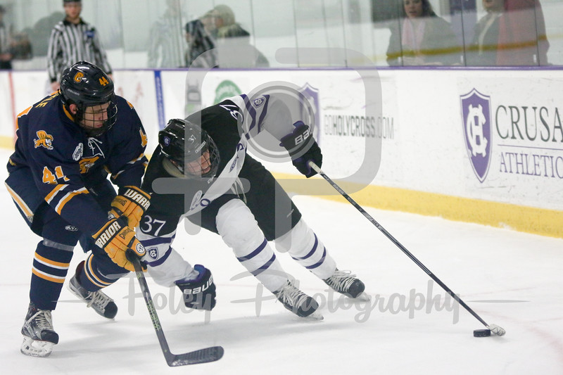 Canisius Golden Griffins defenseman Alex Jaeckle (44) Holy Cross Crusaders forward Brett Mulcahy (37)