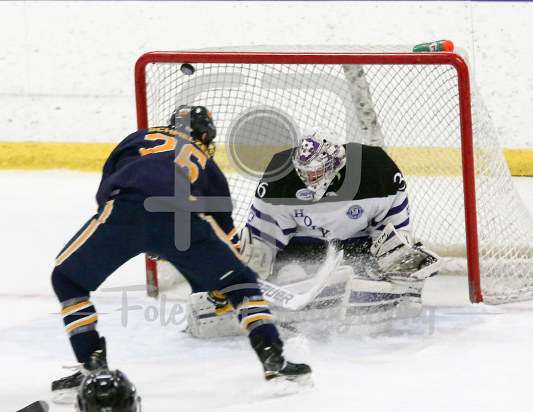 Canisius Golden Griffins forward Ryan Schmelzer (26) Holy Cross Crusaders goalie Paul Berrafato (36)