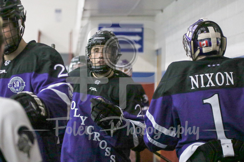 Holy Cross Crusaders forward Brett Lubanski (21) Holy Cross Crusaders goalie Tommy Nixon (1)
