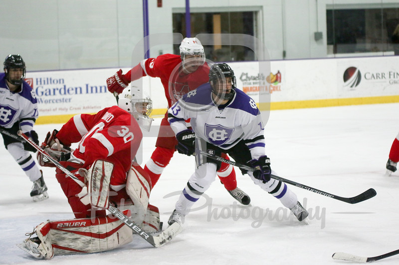 Holy Cross Peter Crinella (13) McGill University goalie Jacob Gervais-Chouinard