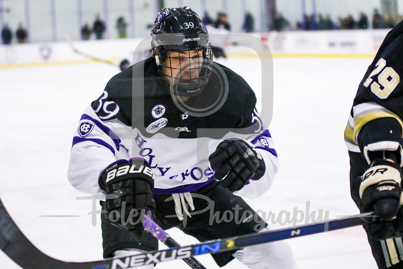 Holy Cross Crusaders forward Mitch Collett (39) Army West Point Black Knights defenseman Mike Preston (29)