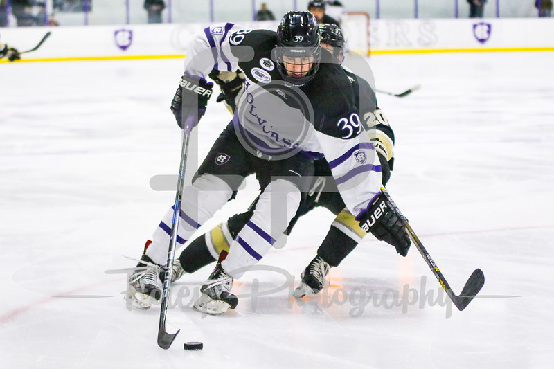 Holy Cross Crusaders forward Mitch Collett (39) Army West Point Black Knights forward Conor Andrle (20)