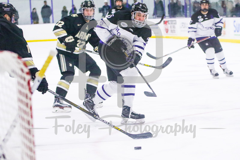 Holy Cross Crusaders defenseman Spencer Trapp (5) Army West Point Black Knights goalie Parker Gahagen (35)