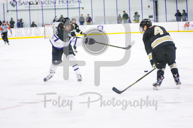 Friday, February 17, 2017; Worcester, MA; Holy Cross Crusaders forward Danny Lopez (27) takes a shot with Army West Point Black Knights defenseman Ryan Nick (4) attempting to block it during the Black Knights 3-1 victory over the Crusaders.