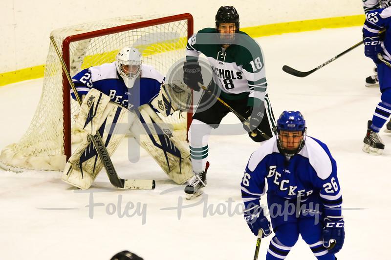 Becker College goalie Tyler Stepke (29) Nichols College forward Ryan Hunter (18)