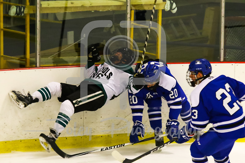 Becker College defenseman Justin Provencher (20) Nichols College forward Nicholas Mangone (26)