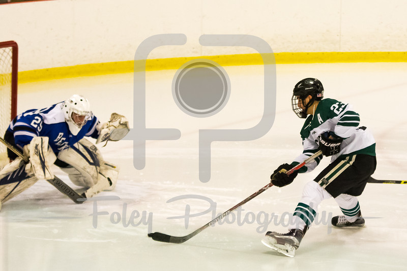 Nichols College forward Scott Cuthrell (23) Becker College goalie Tyler Stepke (29)