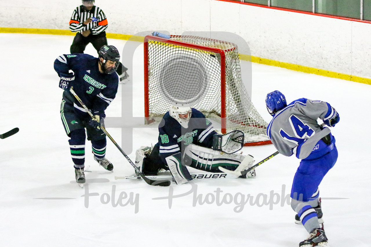 Becker College Hawks forward Connor Merrick (14) Endicott College Gulls goalie Kevin Aldridge (30)
