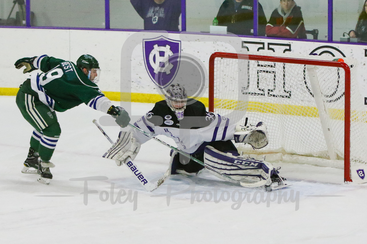 Mercyhurst Lakers forward Taylor Best (19) Holy Cross Crusaders goalie Paul Berrafato (36)