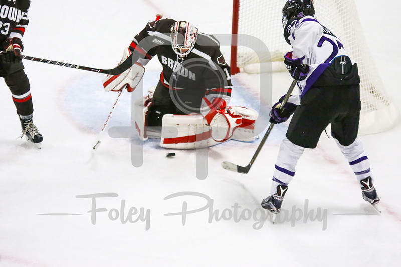 Holy Cross Crusaders forward Danny Lopez (27) Brown Bears goalie Gavin Nieto (1)