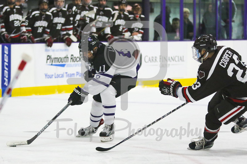 Holy Cross Crusaders forward Michael Laffin (11) Brown Bears defenseman Dane Cooper (23)