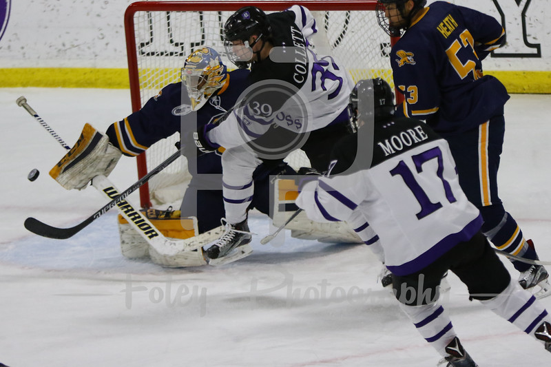Holy Cross Crusaders forward Mitch Collett (39) Canisius Golden Griffins goalie Charles Williams (1)