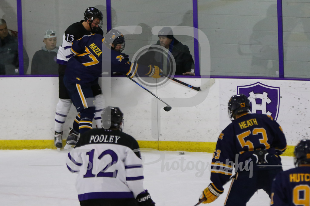 Canisius Golden Griffins defenseman Jimmy Mazza (77) Holy Cross Crusaders forward Peter Crinella (13)