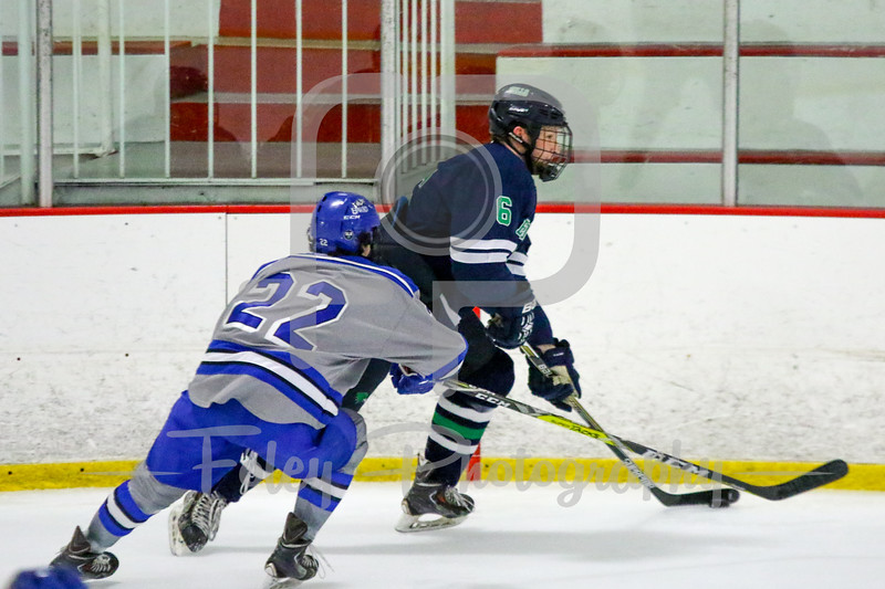 Endicott College Gulls defenseman Connor Costello (6) Becker College Hawks defenseman Bryan Parsons (22)