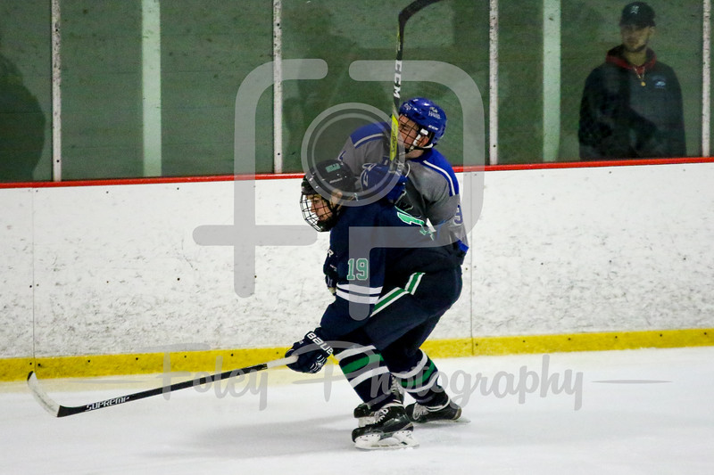Endicott College Gulls defenseman Logan Day (19) Becker College Hawks forward Alex Kielczewski (9)
