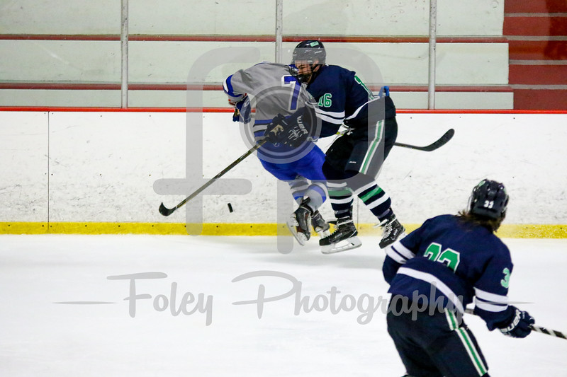 Endicott College Gulls forward Jack Kilty (16) Becker College Hawks defenseman Trey McMillen (7)