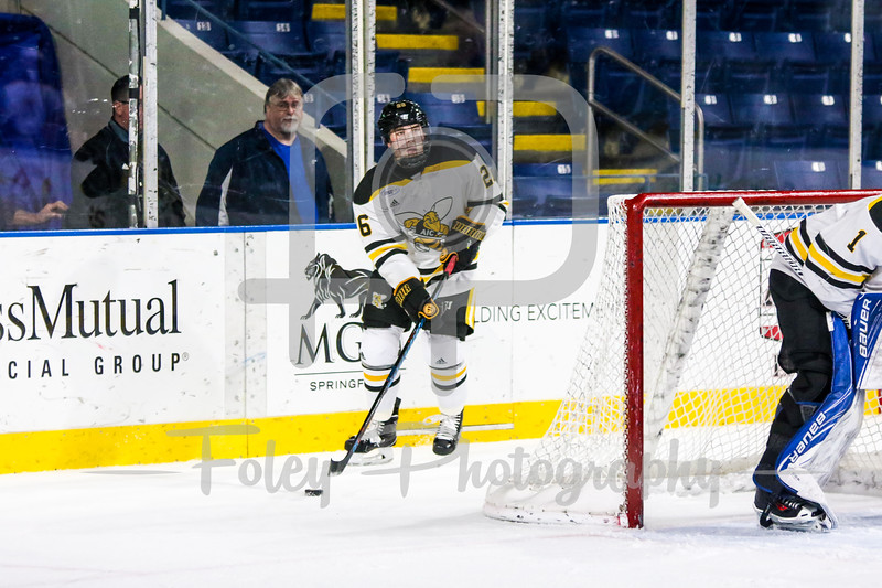 American International Yellow Jackets defenseman Johnny Mueller (26)