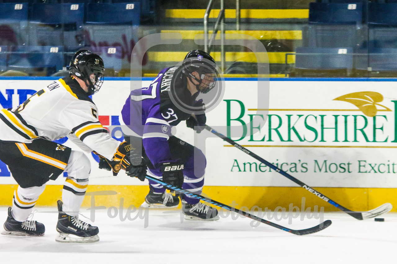 Holy Cross Crusaders forward Brett Mulcahy (37) American International Yellow Jackets defenseman Ryan Polin (5)