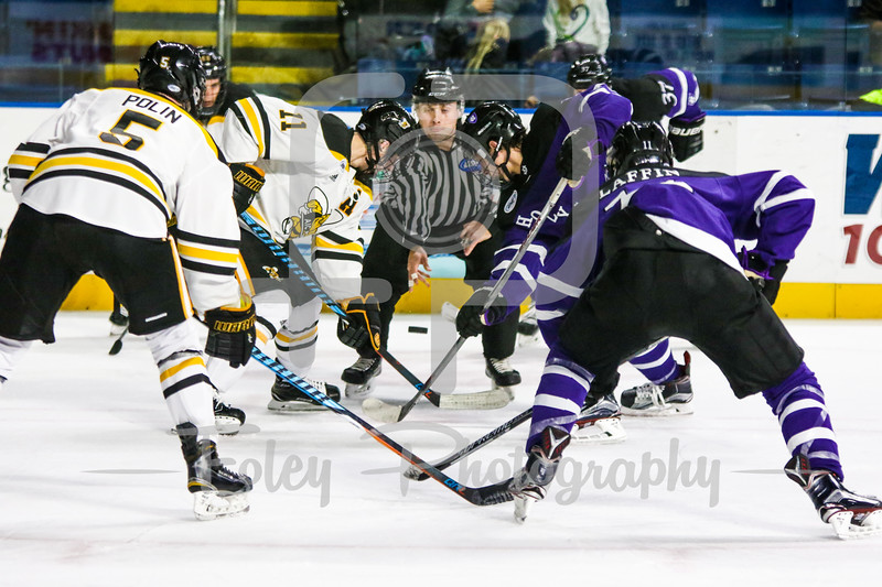 American International Yellow Jackets forward Bryant Christian (11) Holy Cross Crusaders forward T.J. Moore (17)