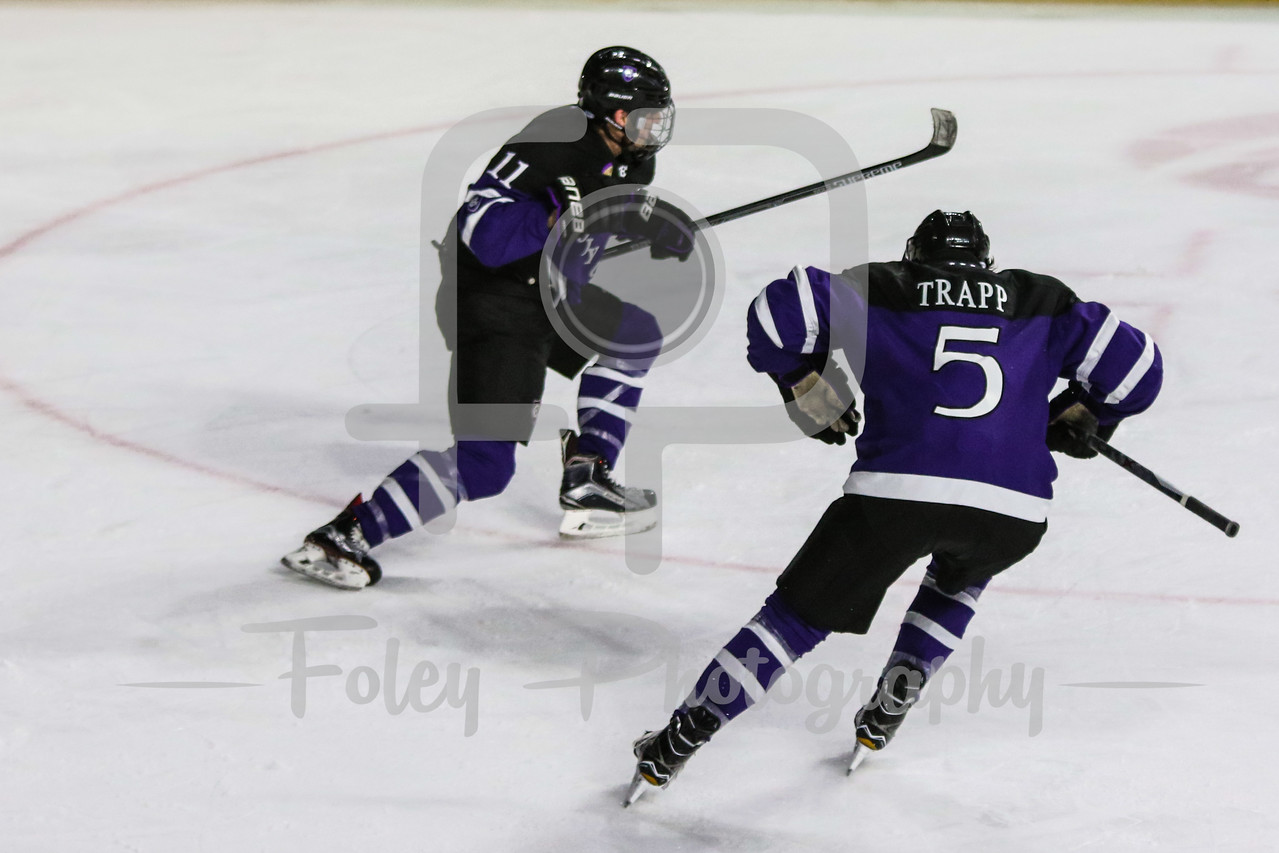 Holy Cross Crusaders forward Michael Laffin (11) Holy Cross Crusaders defenseman Spencer Trapp (5)
