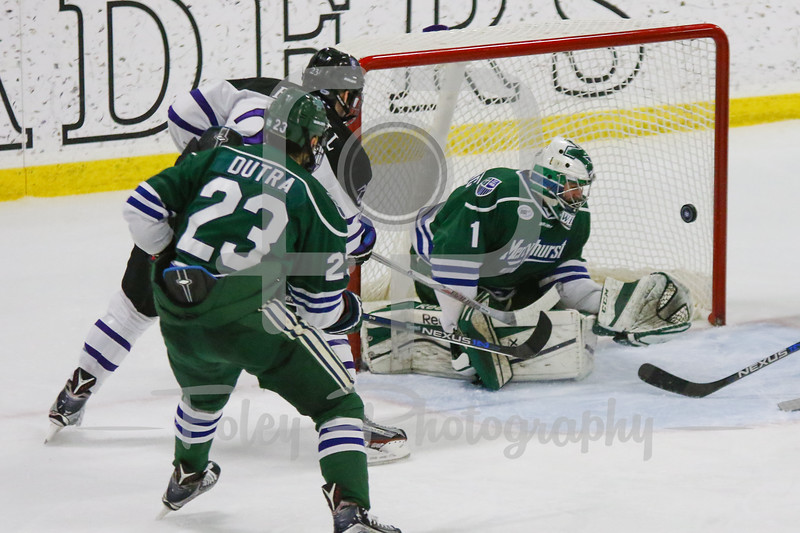 Mercyhurst Lakers goalie Brandon Wildung (1) Holy Cross Crusaders forward Danny Lopez (27)