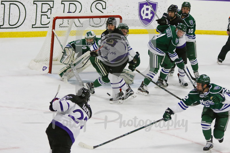 Holy Cross Crusaders forward Danny Lopez (27) Mercyhurst Lakers goalie Brandon Wildung (1)