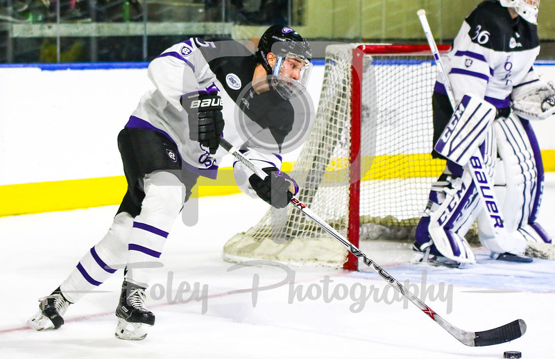 Holy Cross Crusaders defenseman Charlie Barrow (15)