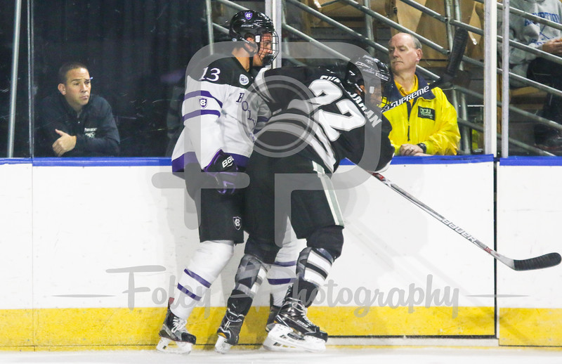 Providence Friars forward Vimal Sukumaran (22) Holy Cross Crusaders forward Peter Crinella (13)