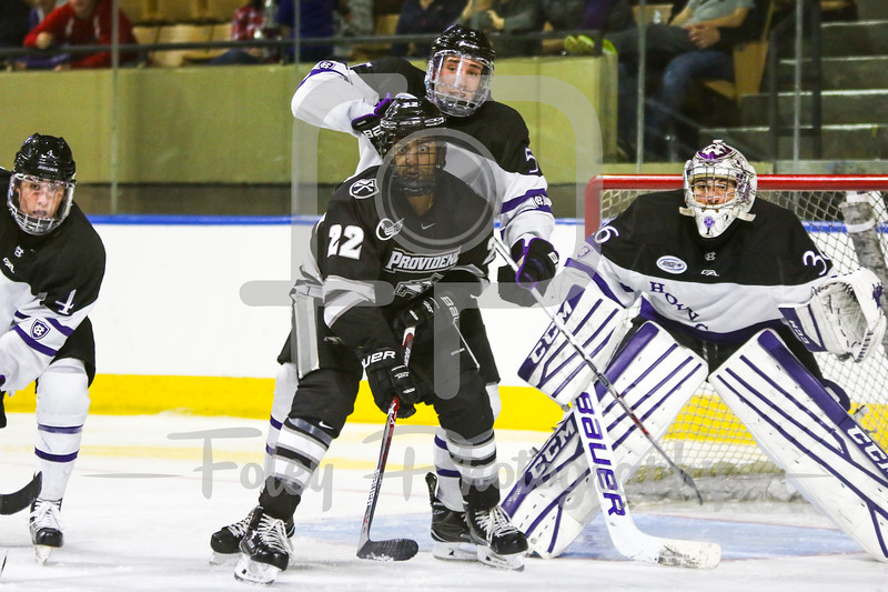 Providence Friars forward Vimal Sukumaran (22) Holy Cross Crusaders defenseman Spencer Trapp (5)