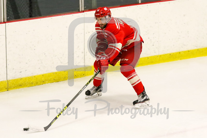 Wednesday, December 28, 2016; Harrisville, RI; A Royal Military College of Canada player tracks down a loose puck during the first period in the Bison 3-1 win over Royal Military College in an exhibition game.