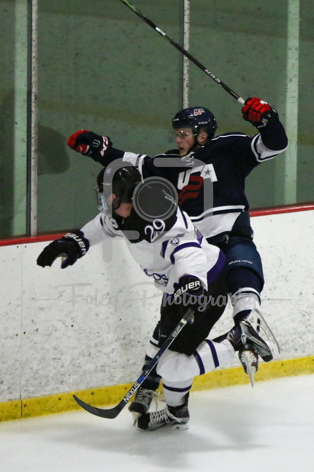Holy Cross forward Mike Barrett (29) USA Hockey National University Team Tyler Opilka (University of Illinois) (22)